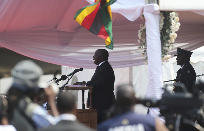 South African President Cyril Ramaphosa delivers his speech during the funeral ceremony of the late former Zimbabwean leader, Robert Mugabe at the National Sports stadium in Harare, Saturday,Sept, 14, 2019. African heads of state and envoys are gathering to attend a state funeral for Mugabe, whose burial has been delayed for at least a month until a special mausoleum can be built for his remains. (AP Photo/Tsvangirayi Mukwazhi)