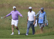 England's Lee Westwood, left gestures as she talks to United States' Dustin Johnson on the 16th fairway during a practice round for the British Open Golf Championship at Royal St George's golf course Sandwich, England, Tuesday, July 13, 2021. The Open starts Thursday, July, 15. (AP Photo/Ian Walton)