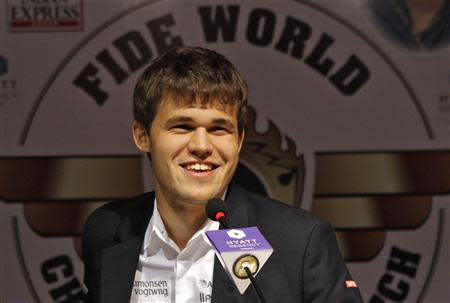 Norway's Magnus Carlsen smiles as he speaks with the media at a news conference after clinching the FIDE World Chess Championship in Chennai