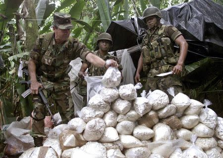 File picture of Colombian Army Gen. Montoya examining a cocaine pack confiscated by troops near Puerto Asis