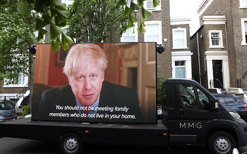 "A ""Led by donkeys"" truck displaying a video of Britain's Prime Minister Boris Johnson, drives by Dominic Cummings' house in London, following the outbreak of the coronavirus disease (COVID-19), London, Britain, May 24 - REUTERS"