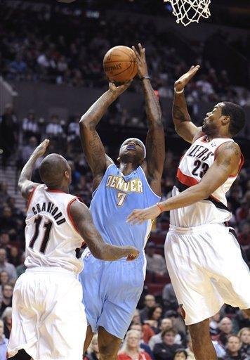 Denver Nuggets' Al Harrington (7) shoots against Portland Trail Blazers' Marcus Canby (23) and Jamal Crawford (11) during the first half of an NBA basketball game in Portland, Ore., Thursday, Dec 29, 2011. (AP Photo/Greg Wahl-Stephens)