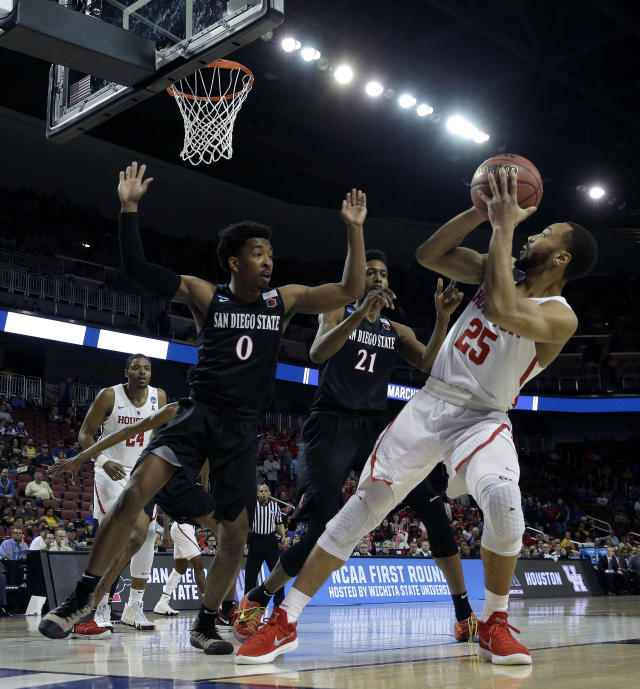 Houston guard Galen Robinson Jr., (25) shoots over San Diego State guard Devin Watson (0) and forward Malik Pope (21) during the first half of an NCAA men's college basketball tournament first-round game Thursday, March 15, 2018, in Wichita, Kan. (AP Photo/Charlie Riedel)