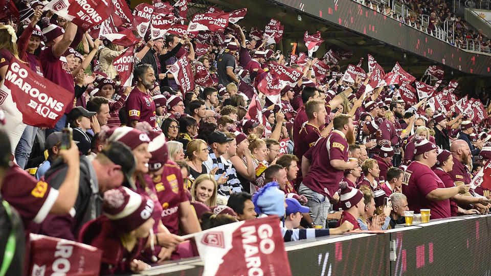 Queensland fans, pictured here booing the Maroons before and after the match on the Gold Coast.