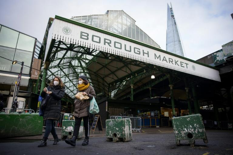 Customers now have to wear face masks as they shop at Borough Market in London