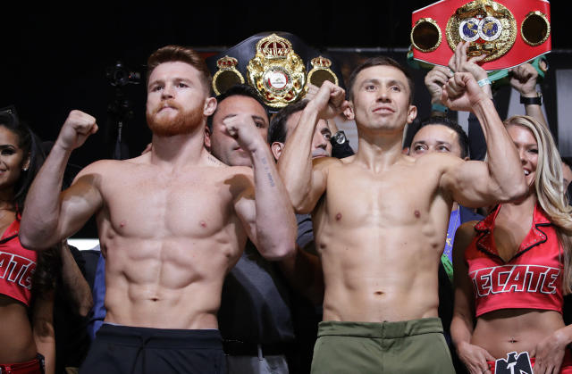 FILE - In this Sept. 15, 2017, file photo, Canelo Alvarez, left, and Gennady Golovkin pose during a weigh-in in Las Vegas. Golovkin's trainer says his fighter was insulted when Alvarez tested positive for a performance enhancing drug that caused their planned May middleweight title rematch to be postponed. (AP Photo/John Locher, File)