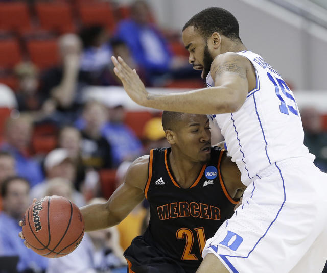 Mercer guard Langston Hall (21) runs into Duke forward Josh Hairston (15) during the first half of an NCAA college basketball second-round game, Friday, March 21, 2014, in Raleigh, N.C. (AP Photo/Gerry Broome)