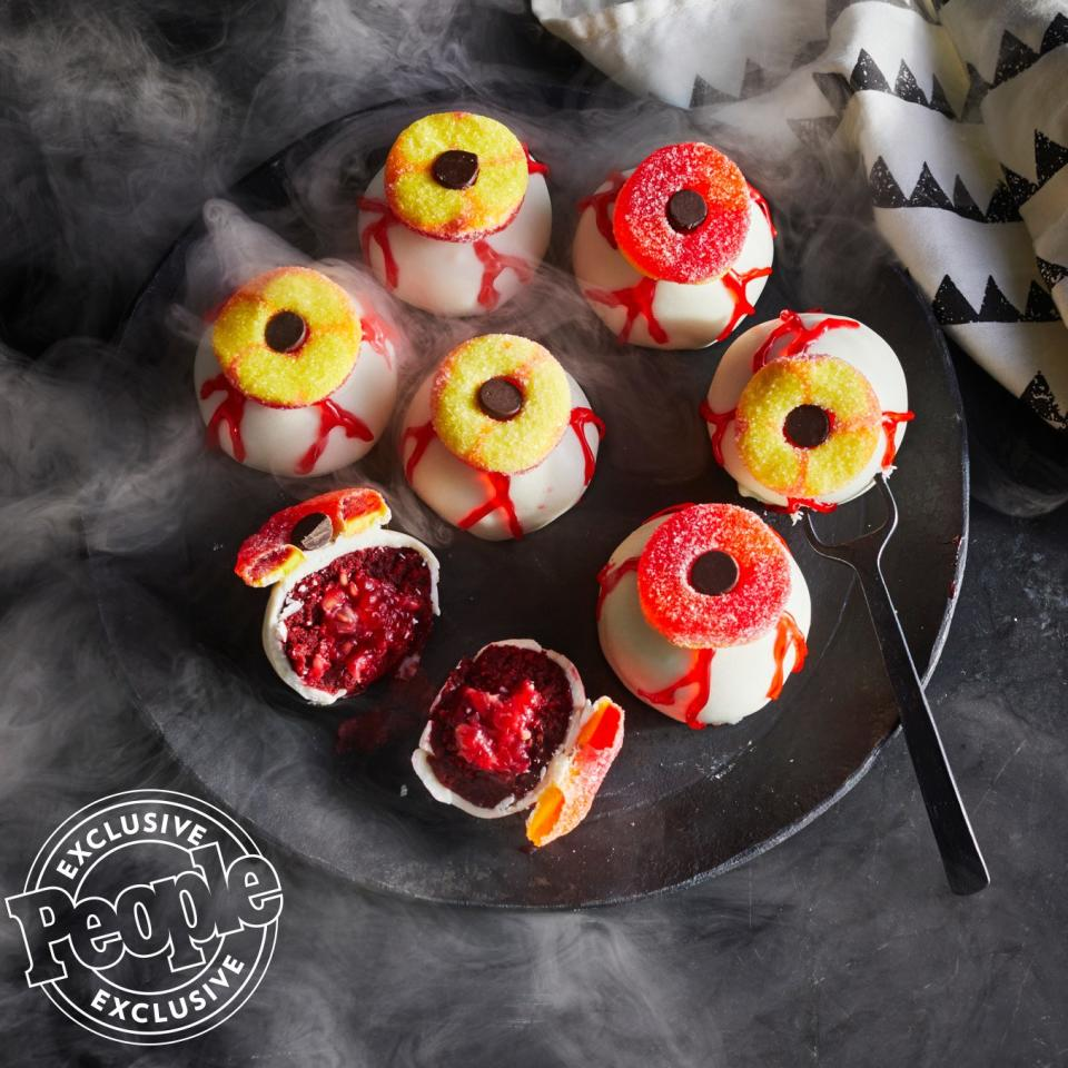"""Zac Young's cake balls are just as creepy as some of the desserts he judges on Food Network's<em> Halloween Baking Championship.</em> The fresh raspberry inside each one gives them that gorey look. Get the recipe <a href=""""https://people.com/food/zac-young-red-velvet-eyeball-cake-truffles/"""">HERE</a>."""