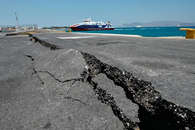 <p>Cracks are seen at the main port on the island of Kos on July 21, 2017, following a 6.5 magnitude earthquake which struck the region. (Phot: Louisa Gouliamaki/AFP/Getty Images) </p>