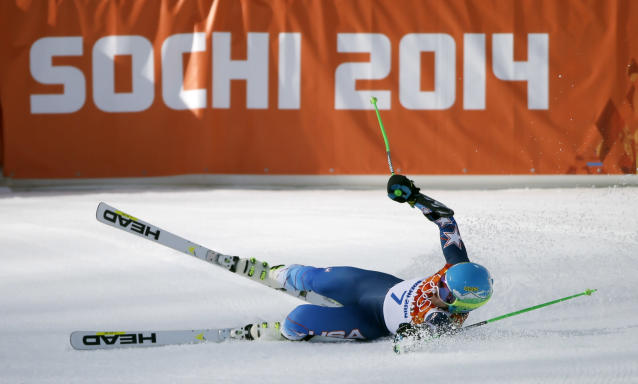 United States' Ted Ligety celebrates winning the gold medal in the men's giant slalom at the Sochi 2014 Winter Olympics, Wednesday, Feb. 19, 2014, in Krasnaya Polyana, Russia.(AP Photo/Christophe Ena)