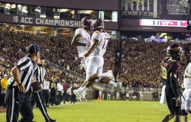 Virginia Tech Hokies wide receiver Damon Hazelton, left, and quarterback quarterback Josh Jackson (17) celebrate a touchdown on their first drive against Florida State during an NCAA college football game in Tallahassee, Fla., Monday, Sept. 3, 2018. (AP Photo/Mark Wallheiser)