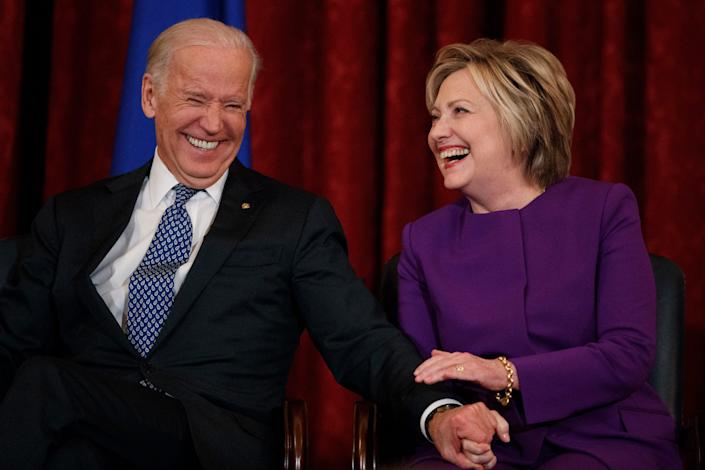Vice President Joe Biden, left, laughs with former Secretary of State Hillary Clinton during a ceremony to unveil a portrait of Senate Minority Leader Harry Reid, D-Nev., on Capitol Hill, Thursday, Dec. 8, 2016, in Washington. (AP Photo/Evan Vucci)
