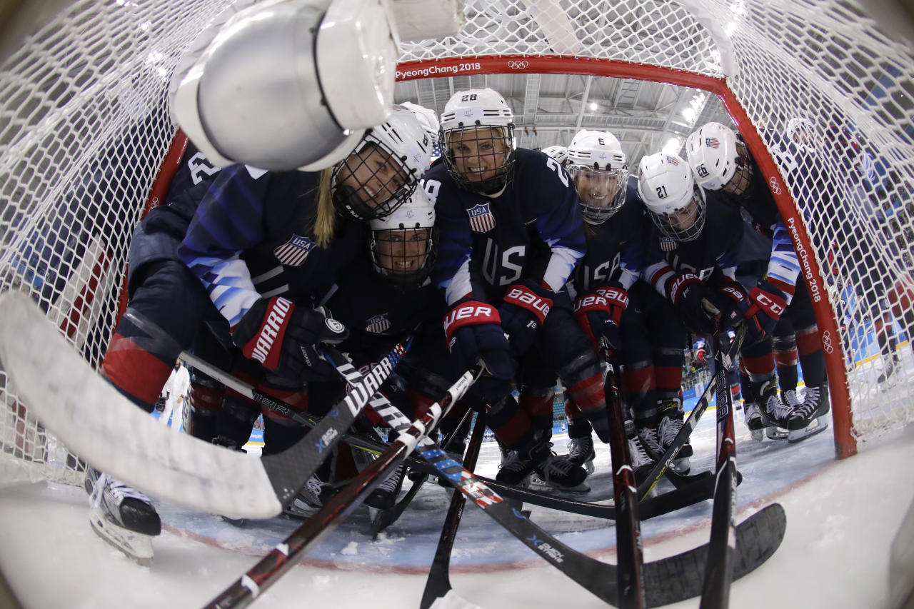 <p>Players from the United States pose for the camera before the semifinal round of the women's hockey game against Finland at the 2018 Winter Olympics in Gangneung, South Korea, Monday, Feb. 19, 2018. (Matt Slocum/Pool Photo via AP) </p>