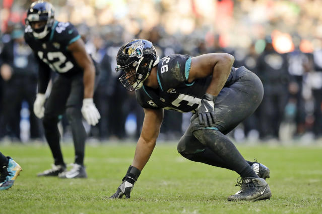 FILE - In this Oct. 28, 2018, file photo, Jacksonville Jaguars defensive end Calais Campbell (93) during the second half of an NFL football game at Wembley stadium in London, Sunday,. Armed with a new contract after being traded from Jacksonville to Baltimore, five-time Pro Bowl defensive end hopes to be a difference-maker in the Ravens' bid to reach the Super Bowl. (AP Photo/Matt Dunham, File)