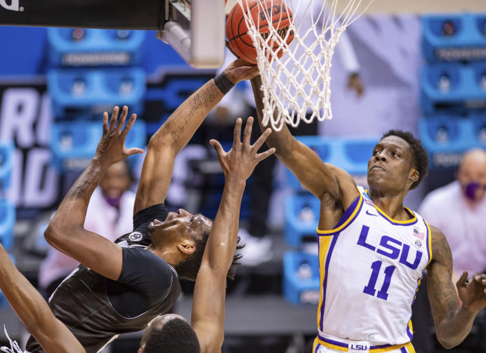 St. Bonaventure forward Osun Osunniyi (21) tries to get a shot past the defense of LSU forward Josh LeBlanc Sr. (11) during the first half of a first round game in the NCAA men's college basketball tournament, Saturday, March 20, 2021, at Assembly Hall in Bloomington, Ind. (AP Photo/Doug McSchooler)