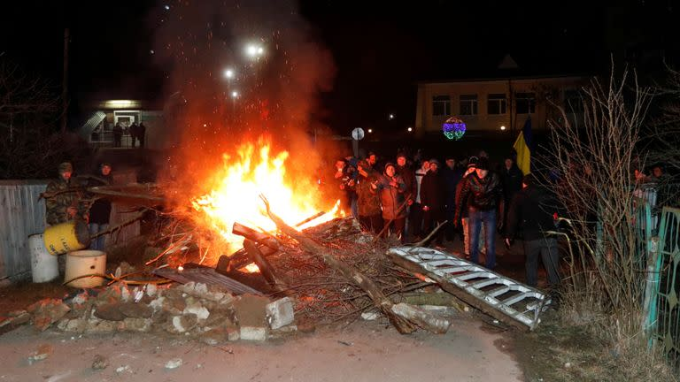 The protesters started fires and erected a barricade in the road