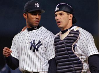 Former Yankees catcher and current manager Joe Girardi talks with Mariano Rivera after the Yankees got out of a bases-loaded jam during a 5-4 victory over the Rangers in 1997