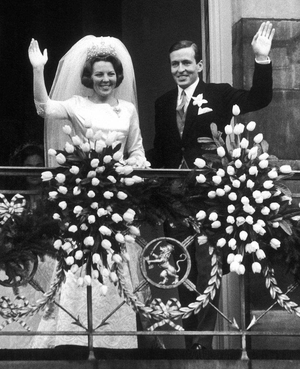 """<p>When Queen Beatrix of the Netherlands got engaged to German diplomat Claus von Amsberg, his background as a member of the Hitler Youth caused outrage. According to <em><a href=""""https://people.com/royals/happy-birthday-princess-beatrix-all-about-the-dutch-monarch-who-abdicated-the-throne-lost-a-son-in-an-avalanche-and-married-a-member-of-the-hitler-youth/"""" rel=""""nofollow noopener"""" target=""""_blank"""" data-ylk=""""slk:People"""" class=""""link rapid-noclick-resp"""">People</a></em>, the Dutch people sent """"a petition to parliament to not grant permission for the marriage, which earned 65,000 signatures."""" However, Beatrix went through with the marriage, and the couple remained married until <a href=""""https://www.telegraph.co.uk/news/obituaries/1409427/H-R-H-Prince-Claus-of-the-Netherlands.html"""" rel=""""nofollow noopener"""" target=""""_blank"""" data-ylk=""""slk:Prince Claus's death in 2002"""" class=""""link rapid-noclick-resp"""">Prince Claus's death in 2002</a>. </p>"""