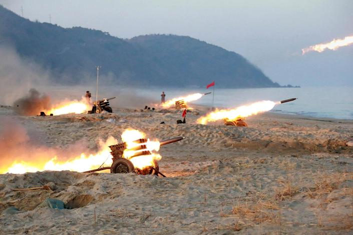 <p>A view of a firing contest among multiple launch rocket system (MLRS) batteries selected from large combined units of the KPA, Dec. 21, 2016. (KCNA/Reuters) </p>