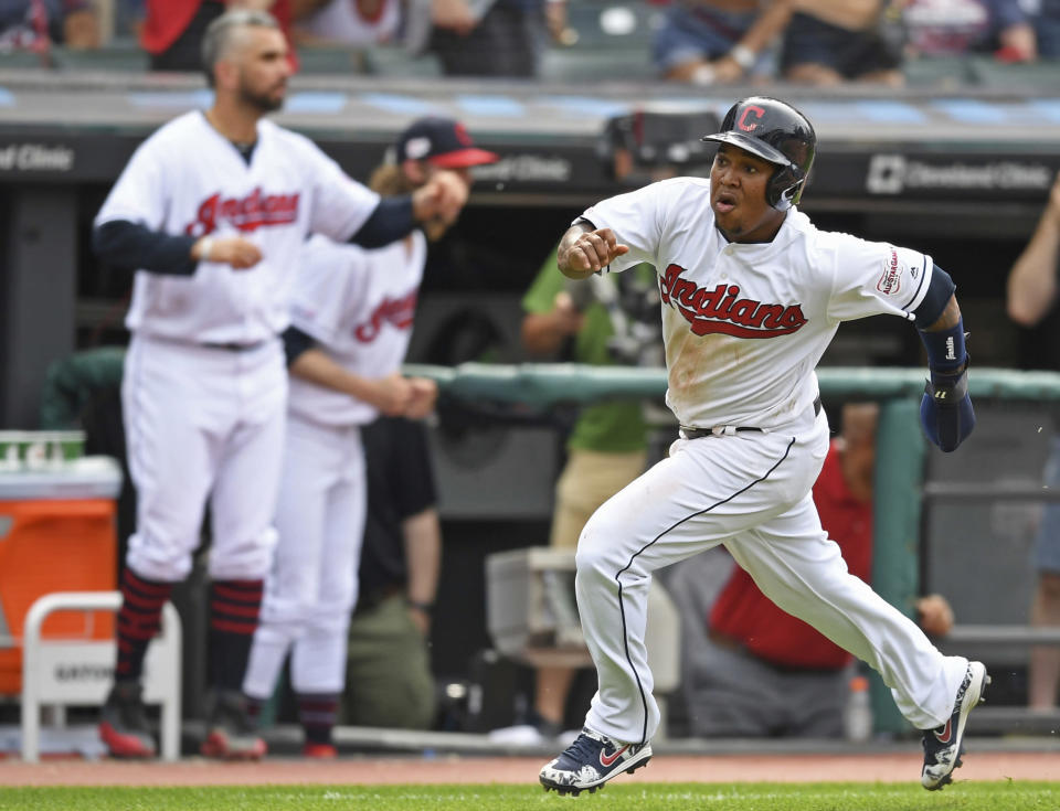 Cleveland Indians' Jose Ramirez, right, scores on an error by New York Yankees' Didi Gregorius in the ninth inning of a baseball game, Sunday, June 9, 2019, in Cleveland. Francisco Lindor was safe on a fielder's choice. (AP Photo/David Dermer)