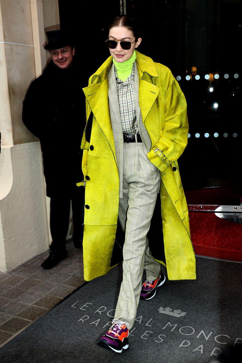 <p>Gigi has been blessed with the otherworldly ability to pull off even the wildest outfit. She literally wore neon, on plaid, on more plaid, on more neon, with a statement shoe – AND PULLED IT OFF. How?! Just how?!?</p>