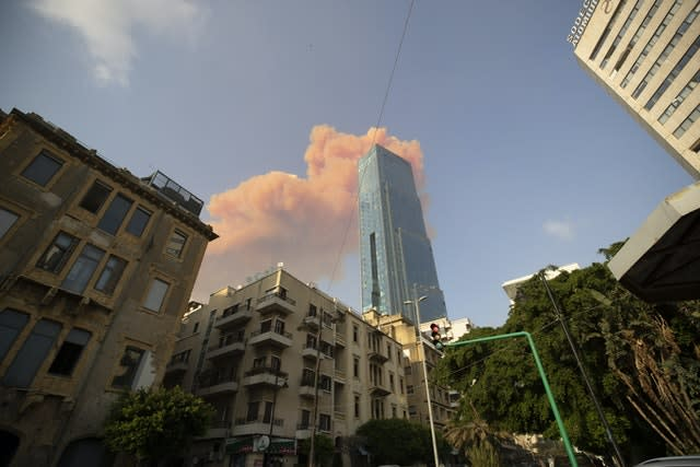 A cloud from a massive explosion is seen in in Beirut (Hasssan Ammar/AP)