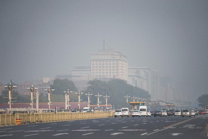 Despite all-out efforts to give the Chinese Communist Party blue skies for its twice-a-decade congress, Beijing's notorious smog has cloaked the mega-city in its trademark toxic haze (AFP Photo/FRED DUFOUR)