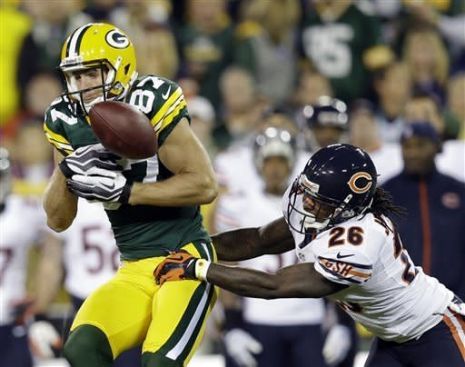 Chicago Bears cornerback Tim Jennings (26) breaks up a pass intended for Green Bay Packers wide receiver Jordy Nelson (87) during the first half of an NFL football game Thursday, Sept. 13, 2012, in Green Bay, Wis. (AP Photo/Morry Gash)