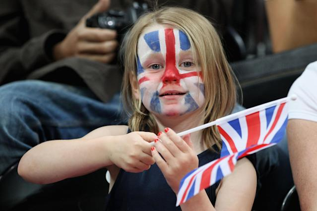 LONDON, ENGLAND - JULY 28: A junior fan cheers for Great Britain as they take on Australia during Women's Basketball on Day 1 of the London 2012 Olympic Games at the Basketball Arena on July 28, 2012 in London, England. (Photo by Christian Petersen/Getty Images)