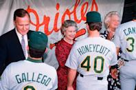 <p>The Queen attends an American baseball game with President and First Lady Bush. </p>