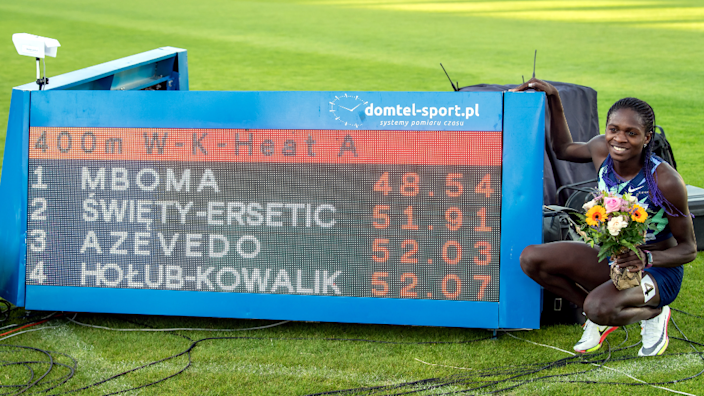 Namibian Christine Mboma posing next to a sign showing her record-breaking time for the the under-20 women's 400m race in Bydgoszcz, Poland - Wednesday 30 June 2021