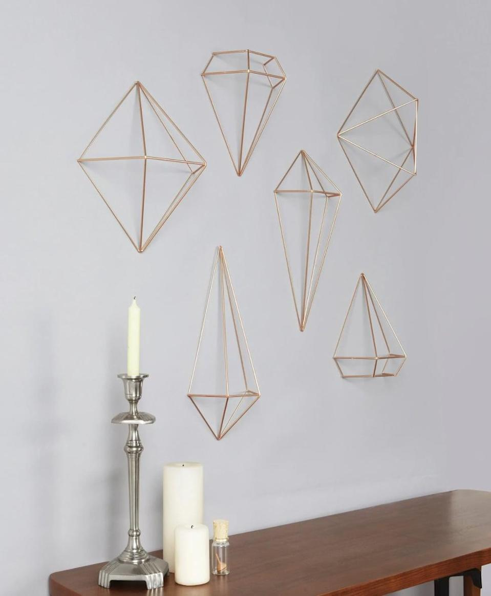 <p>Give your space a modern sleek look with the <span>Umbra 6 Piece Prisma Wall Decor</span> ($50). These can be wall mounted, hung from the ceiling, or displayed on a table top, you can even use them as an innovative air plant holder. It comes in black, copper, or brass.</p>
