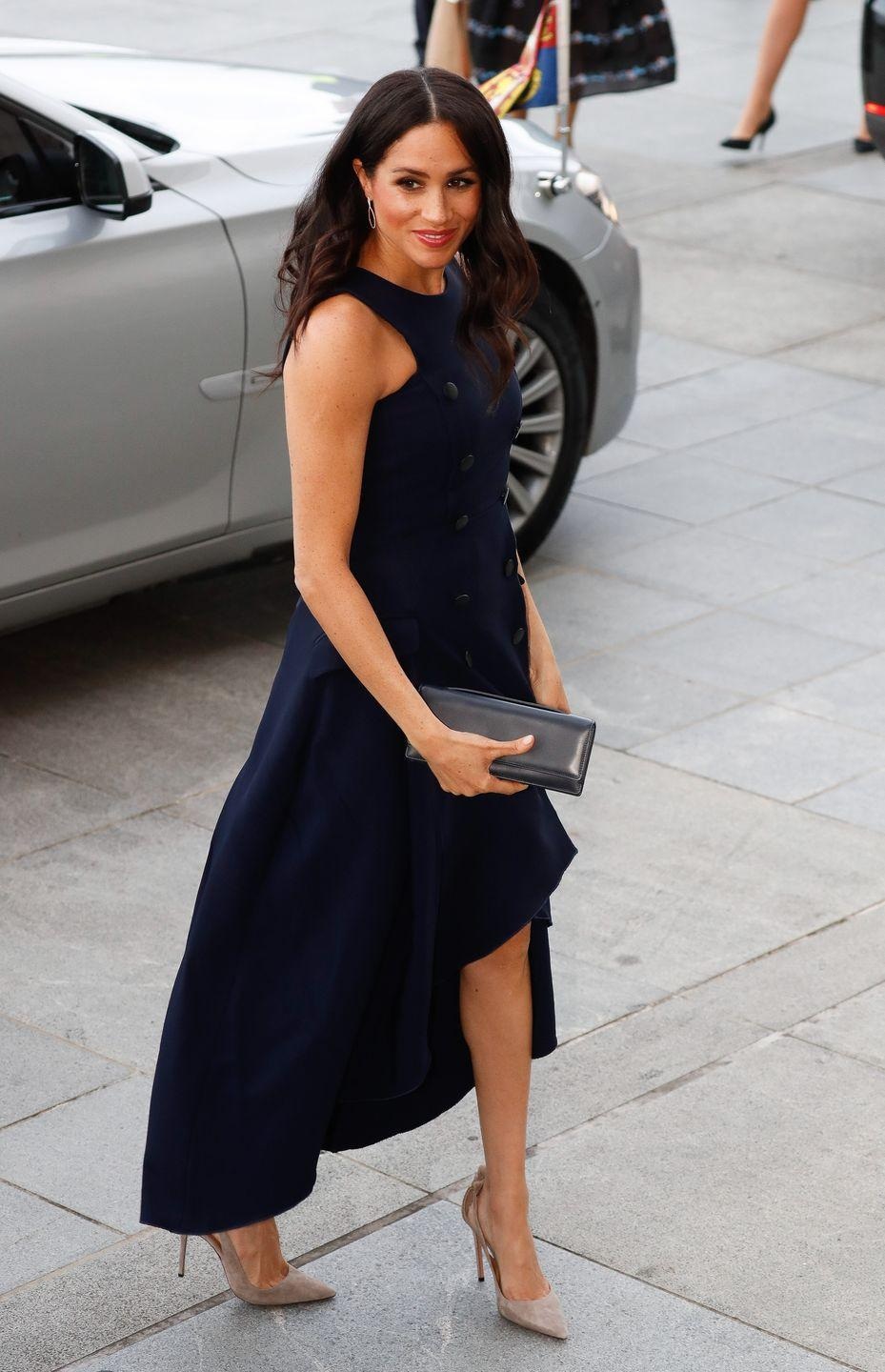 """<p>We all have to wear the same clothes over and over. Why can't the royals? Well, actually, they sometimes do! During the royal tour in New Zealand, Meghan sported a ruffled navy midi dress that has a romantic history for the couple: She wore it on her very first public outing with Prince Harry, <a href=""""https://www.eonline.com/news/981830/meghan-markle-recycles-a-dress-from-her-first-public-outing-with-prince-harry?cmpid=rss-000000-rssfeed-365-fashion"""" rel=""""nofollow noopener"""" target=""""_blank"""" data-ylk=""""slk:E! Online points out"""" class=""""link rapid-noclick-resp"""">E! Online points out</a>. So sweet! </p>"""