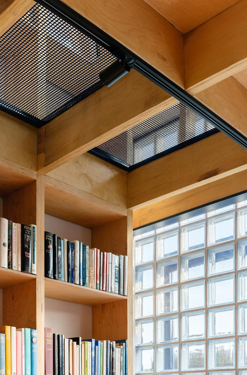 """They picked a mesh floor for the reading nook on the second level so that sunshine could stream in from multiple directions. """"There are a number of interesting relationships between the living spaces of the home,"""" Qianyi says."""