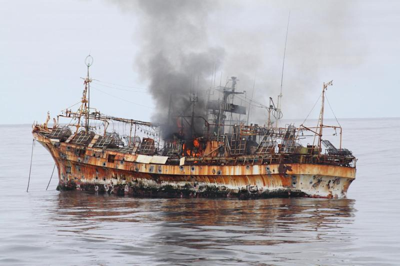 In this photo provided by the U.S. Coast Guard, a plume of smoke rises from the derelict Japanese ship Ryou-Un Maru after it was hit by canon fire by a U.S. Coast Guard cutter on Thursday, April 5, 2012, in the Gulf of Alaska. The Coast Guard decided to sink the ship dislodged by last year's tsunami because it was a threat to maritime traffic and could have an environmental impact if it grounded. (AP Photo/U.S. Coast Guard)