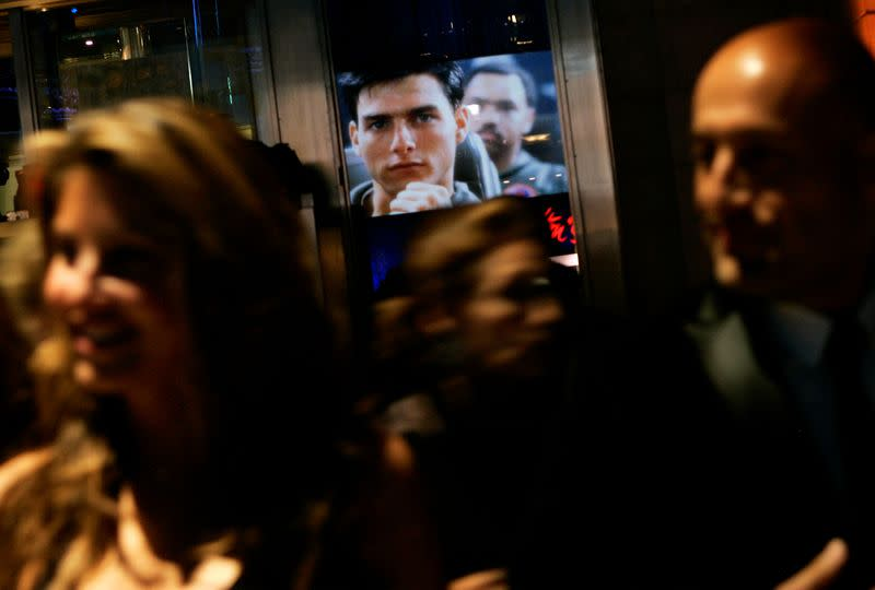 """FILE PHOTO: An image of Cruise from the movie """"Top Gun"""" is reflected in a window in New York"""