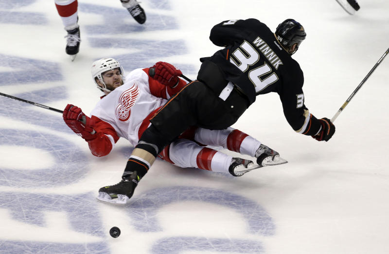Detroit Red Wings defenseman Carlo Colaiacovo, left, and Anaheim Ducks center Daniel Winnik collide during the first period in Game 7 of their first-round NHL hockey Stanley Cup playoff series in Anaheim, Calif., Sunday, May 12, 2013. (AP Photo/Chris Carlson)