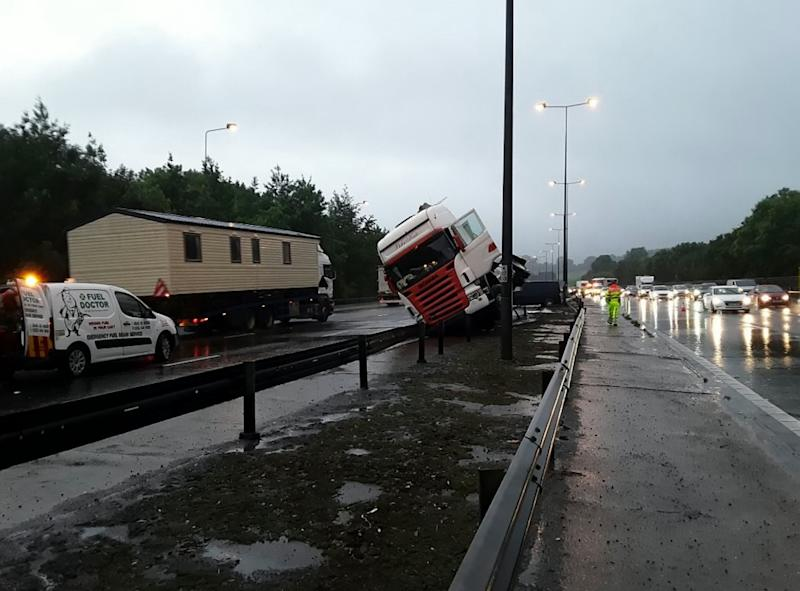 The wet weather led to a crash between Junction 7 and 8 on the M25, not far from where two sinkholes opened up (Picture: SWNS)