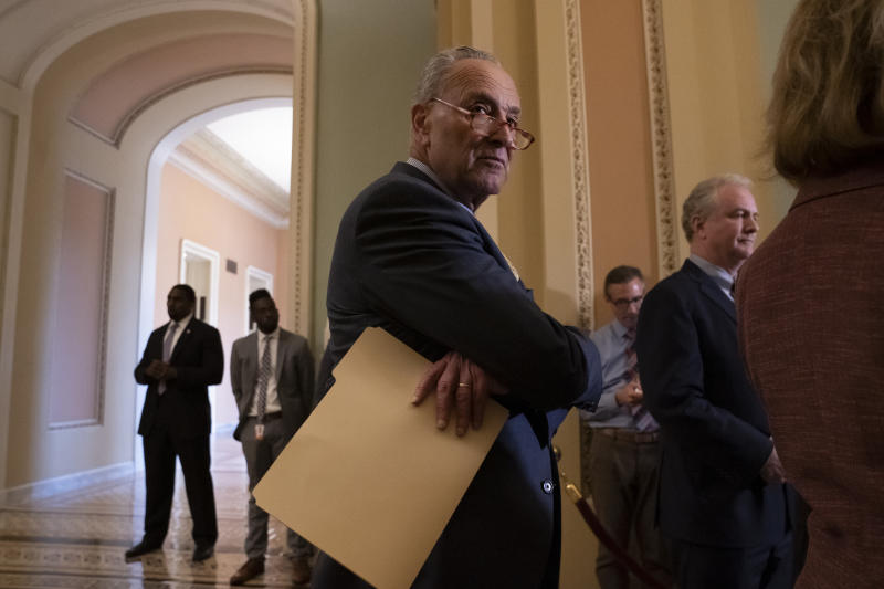 Senate Minority Leader Chuck Schumer, D-N.Y., joined at right by Sen. Chris Van Hollen, D-Md., pauses during a news conference at the Capitol in Washington, Tuesday, Sept. 17, 2019. (AP Photo/J. Scott Applewhite)