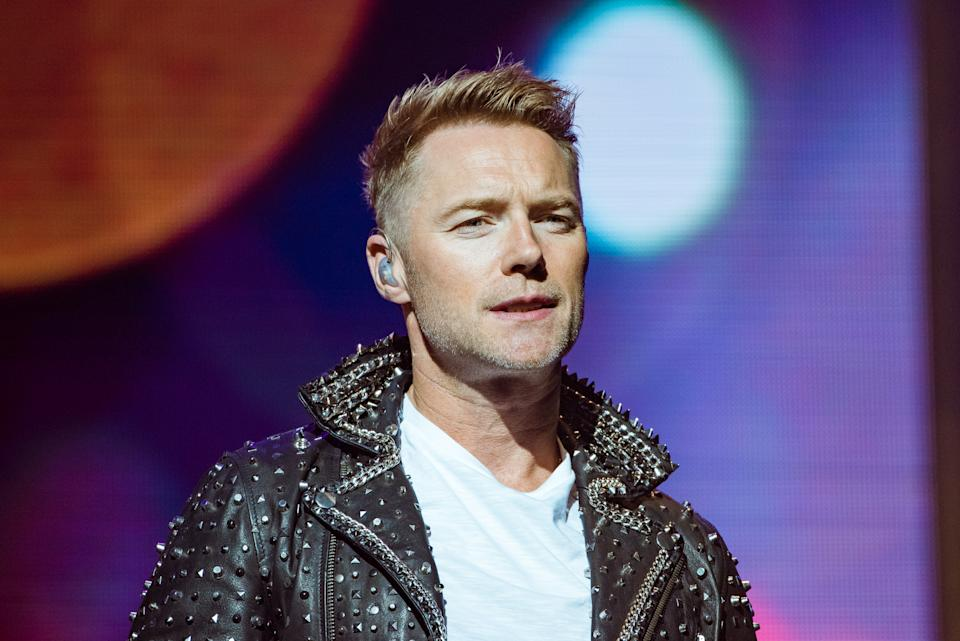 """Ronan Keating of Boyzone performs on stage at the London Palladium during their """"The Last Five tour"""" on October 21, 2019 in London, England.  (Photo by Joseph Okpako/WireImage)"""