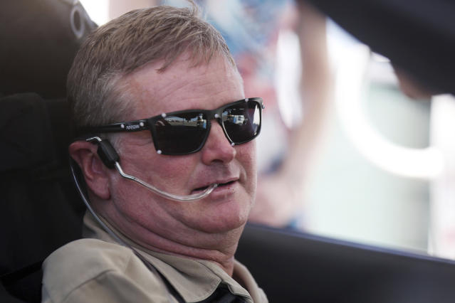 FILE - In this Tuesday, Sept. 27, 2016 file photo,Indy Racing League driver Sam Schmidt prepares to drive his modified Corvette, in Las Vegas. Schmidt was paralyzed from the neck down in a crash 16 years ago. Sam Schmidt was left quadriplegic from a racing accident and the team he later created has suffered a series of tragedies and setbacks. (AP Photo/Isaac Brekken, File)