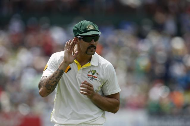 Australia's Mitchell Johnson responds to comments from South African supporters during the fourth day of their first cricket test match in Pretoria, February 15, 2014. REUTERS/Mike Hutchings (SOUTH AFRICA - Tags: SPORT CRICKET)