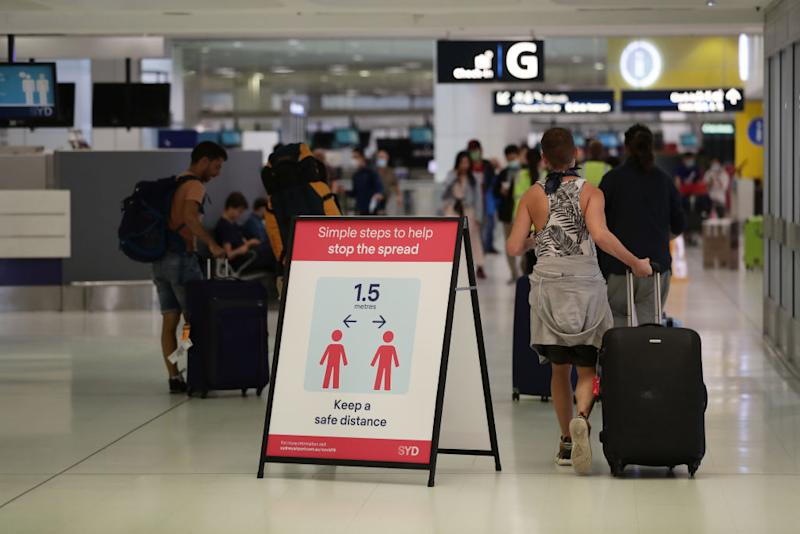 Health advice notices are seen at Sydney International Airport on March 25, 2020. Source: Getty