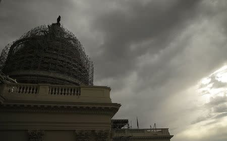 Storm clouds approach the US Capitol dome in Washington