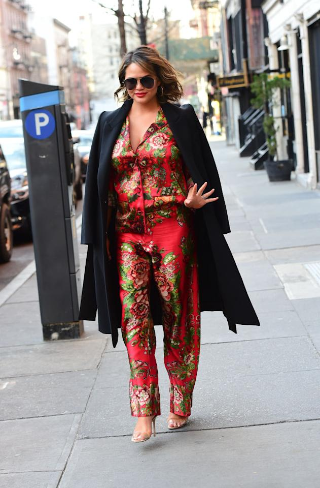 <p>Model Chrissy Teigen showed us how to perfect the pyjamas-in-public trend with this Chinese print piece. She was seen walking in Soho in New York City, with a black coat and open toe shoes to pull the two piece together. (Raymond Hall/GC Images) </p>