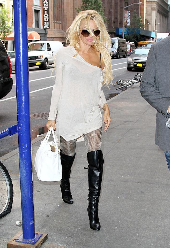 "As if wearing white after Labor Day wasn't bad enough, Pam Anderson paired the see-through tee with shimmery tights (worn as pants) and black thigh-high boots that looked straight out of a dominatrix's closet. At 45, perhaps the former ""Baywatch"" babe should tone it down ... and cover up! (9/27/2012)"