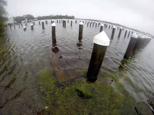 <p>Many docks and boat ramps like this one on Cinco Bayou are submerged in water due to flooding from Hurricane Nate on Sunday, Oct. 8, 2017, in Fort Walton Beach, Fla. (Photo: Nick Tomecek/Northwest Florida Daily News via AP) </p>