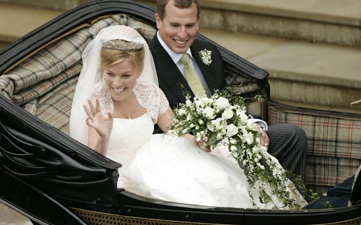 Peter Phillips and Autumn Kelly leave St George's Chapel in Windsor after their marriage vows in May 2008 - SANG TAN/AFP
