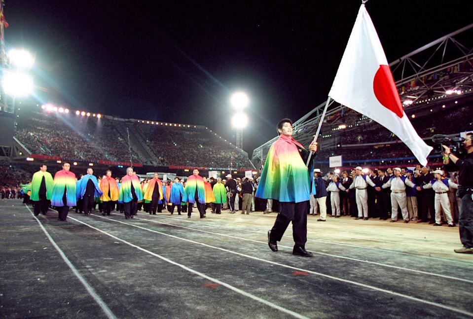 15 Sep 2000:  Flag Bearer and Judo competitor Kosei Inoue leads the Japan Olympic Team round during the Opening Ceremony of the Sydney 2000 Olympic Games at the Olympic Stadium in Homebush Bay, Sydney, Australia. Mandatory Credit: Jed Jacobsohn /Allsport