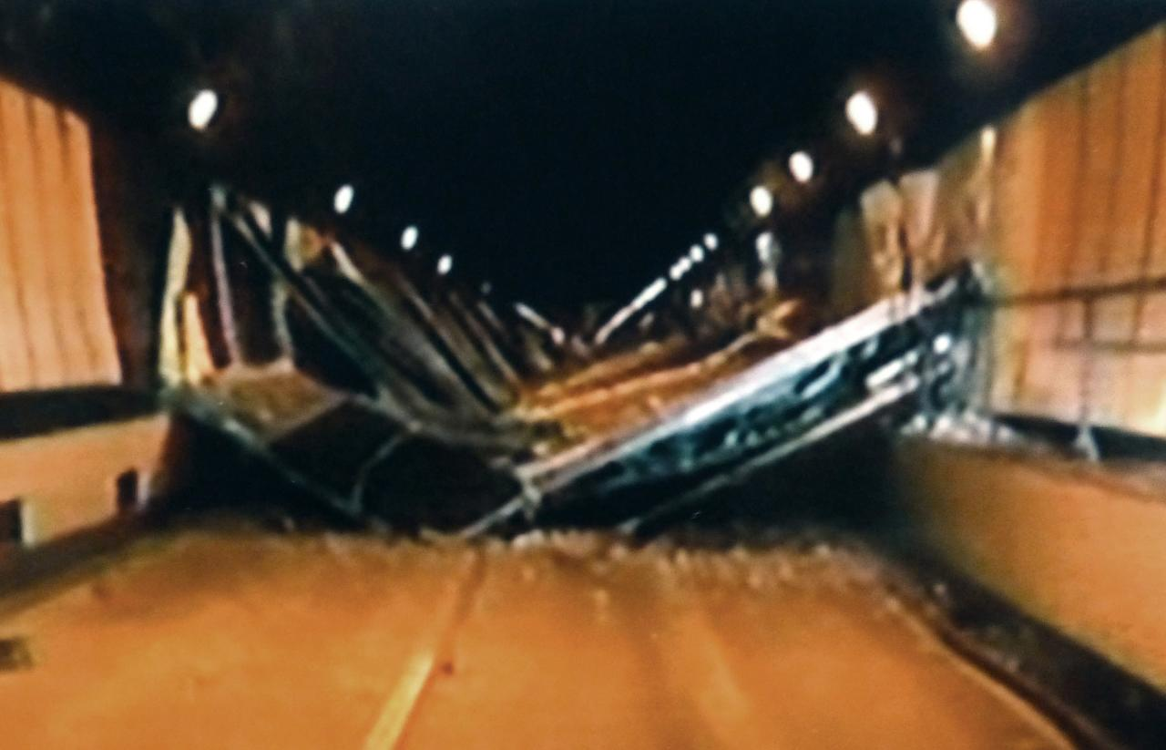 In this image made off video footage taped Sunday afternoon, Dec. 2, 2012 by Yamanashi Prefectural Police and distributed Monday by Kyodo News, concrete ceiling panels collapse inside the Sasago Tunnel on the Chuo Expressway in Koshu, Yamanashi Prefecture, central Japan. The structure fell onto moving vehicles deep inside the tunnel Sunday morning, and authorities confirmed nine deaths before suspending rescue work Monday while the roof was being reinforced to prevent more collapses. (AP Photo/Kyodo News) JAPAN OUT, MANDATORY CREDIT, NO LICENSING IN CHINA, FRANCE, HONG KONG, JAPAN AND SOUTH KOREA